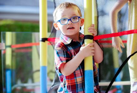 Boy with glasses at a soft play centre